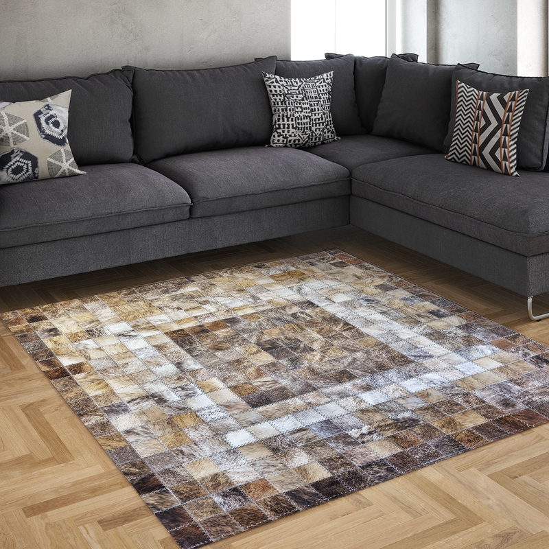 Small Nguni hide squares make up this variegated rug design
