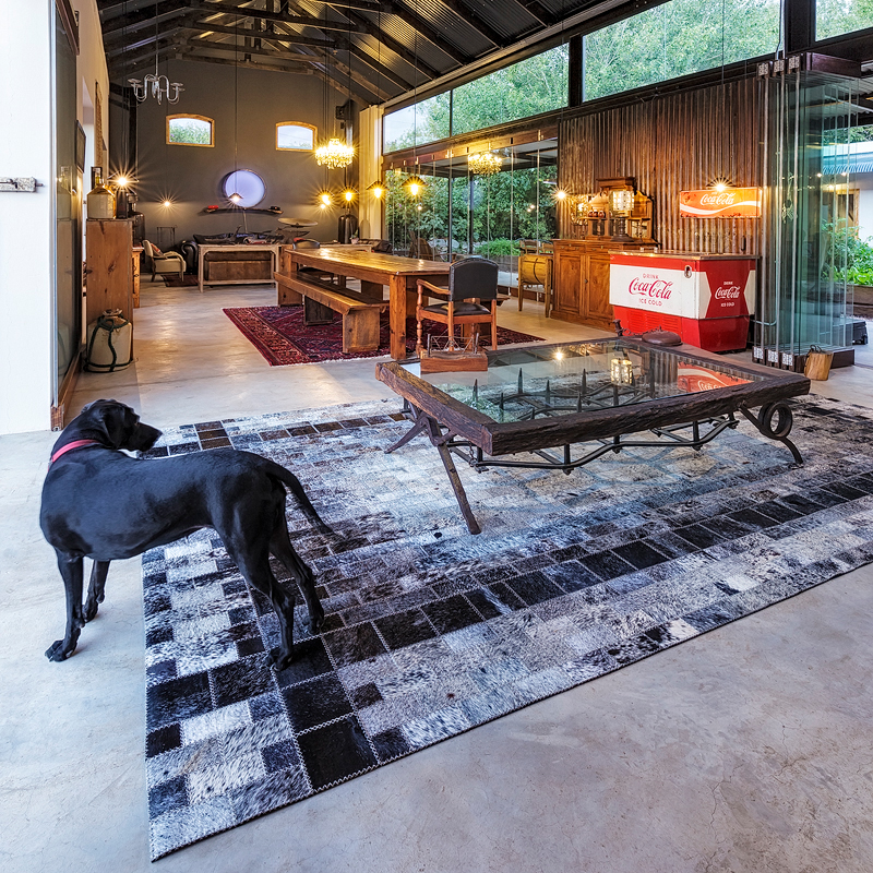 Cowhide rug under coffee table by Inkomo Products