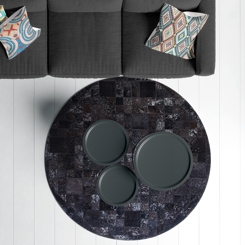 Cowhide rug round by Inkomo Products | Black leather rugs
