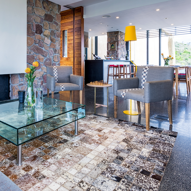Inkomo hand stitched cowhide rugs | custom rug created for Almenkerk Wine Estate, Grabouw